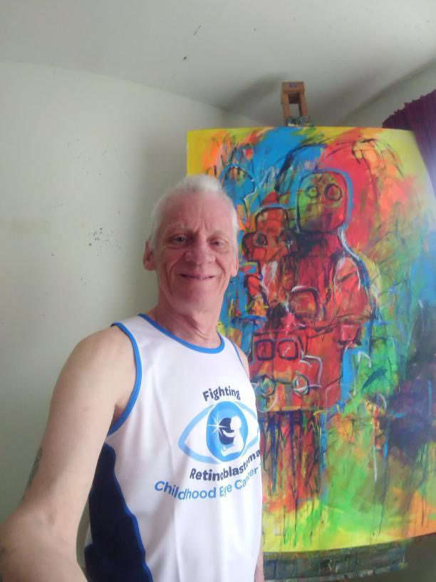 Daniel Pincham-Phipps with his artwork in support of Childhood Eye Cancer Trust